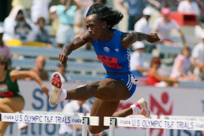 Jackie Joyner jumping hurdles.