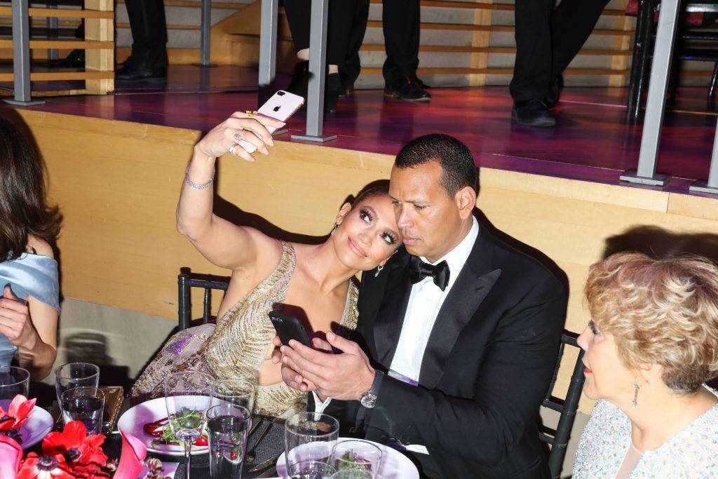 Jennifer Lopez and Alex Rodriguez take a selfie at the dinner table in 2018