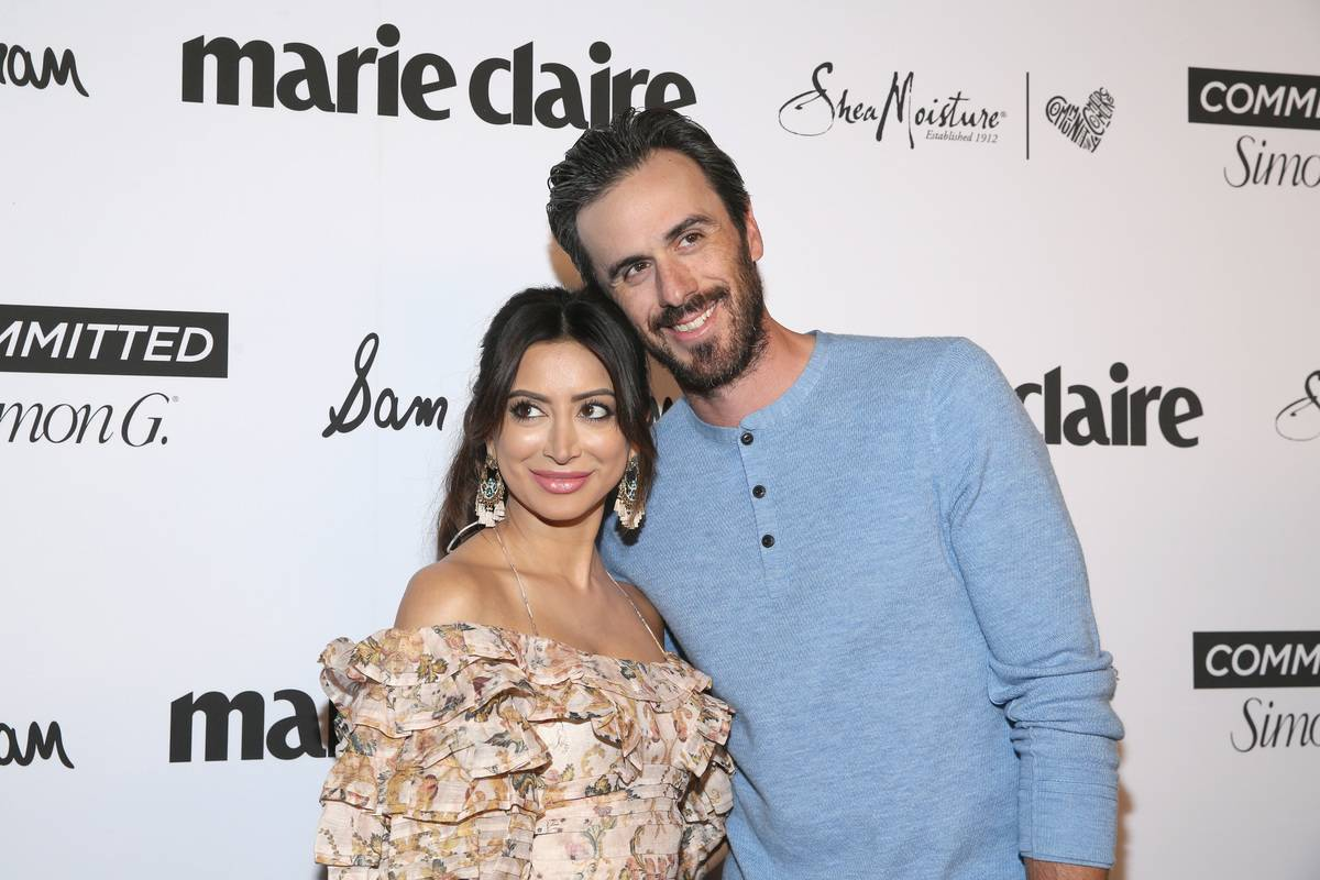 Ryan and Noureen pose together at a Marie Claire event.