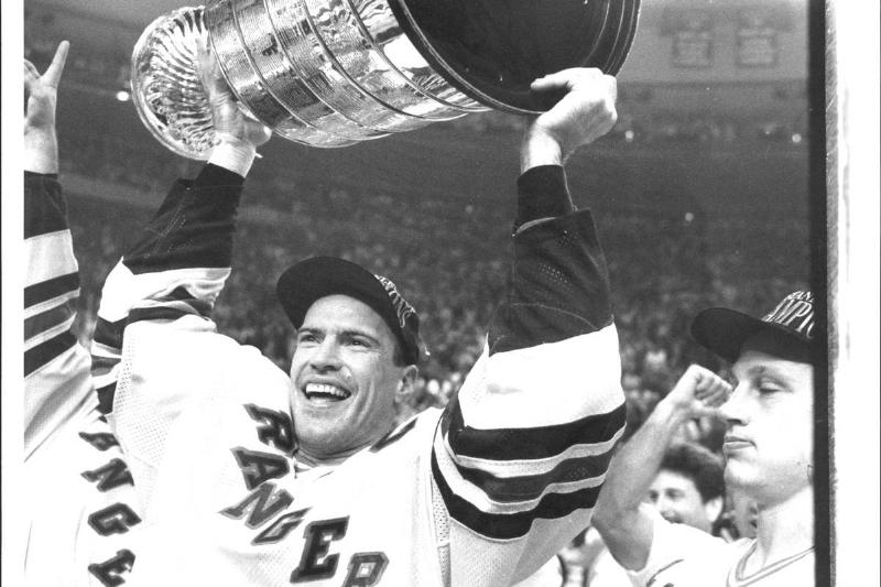 New York Rangers Mark Messier holds the Stanley Cup over his head in 1994.