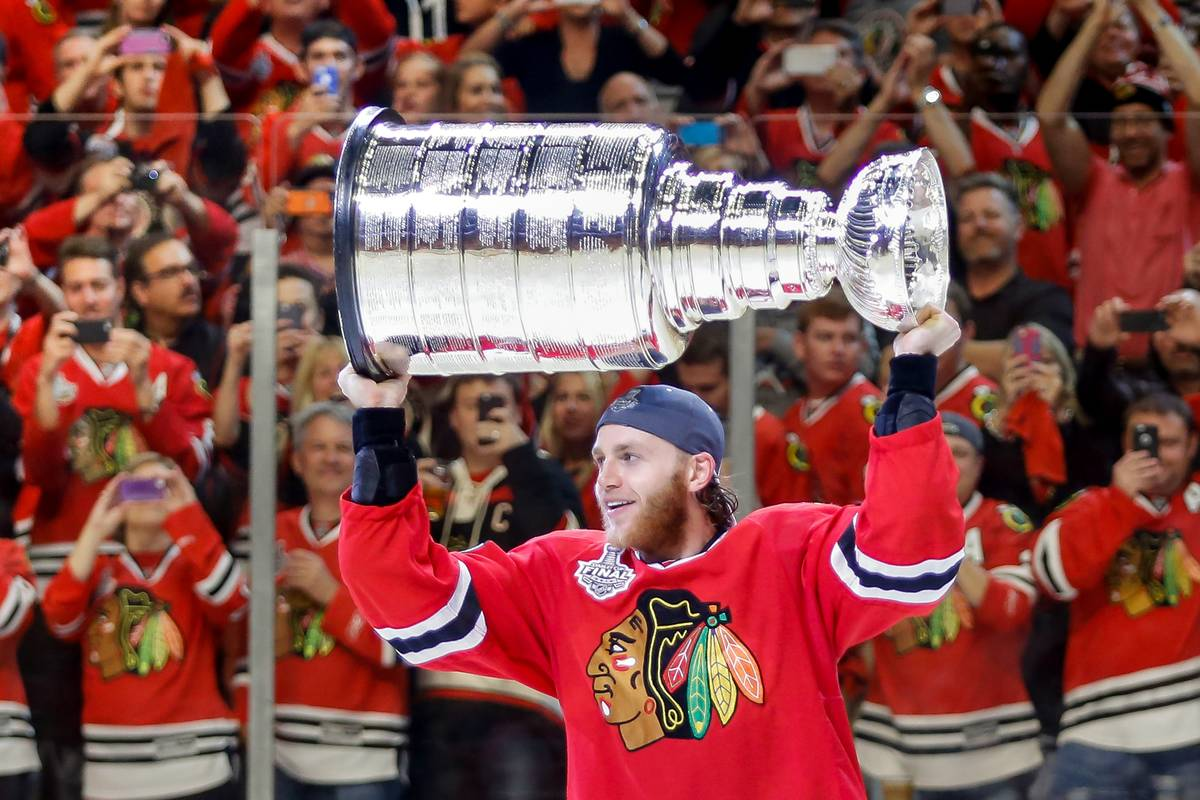 Patrick Kane holds up the Stanley Cup.
