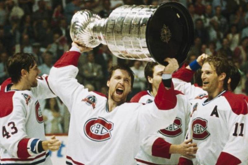 Patrick Roy raises the 1993 Stanley Cup.