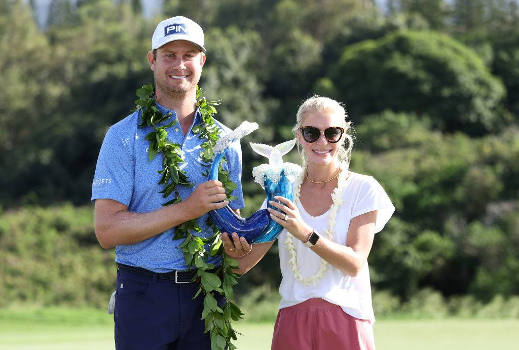 Harris English of the United States poses with the trophy and his wife, Helen Marie Bowers