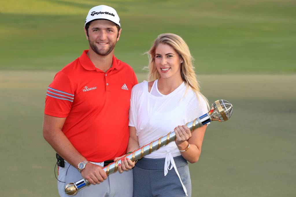 Jon Rahm of Spain poses with the trophy and girlfriend Kelley Cahill