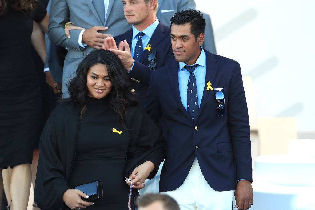 Tony Finau of the United States and wife Alayna Finau depart the opening ceremony