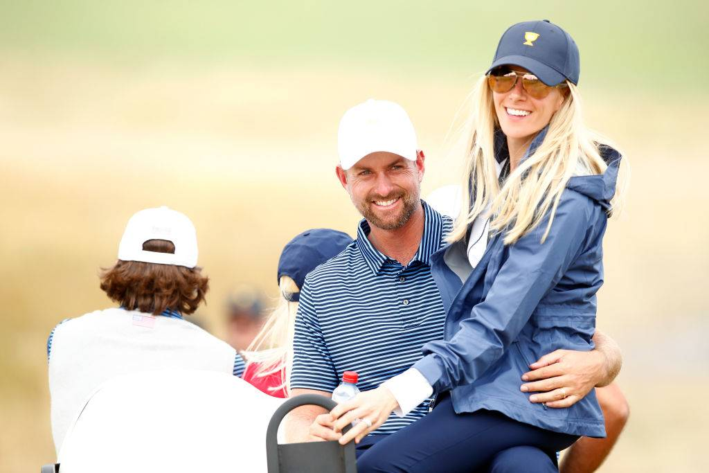 Webb Simpson of the United States team and wife Taylor Simpson ride in a cart