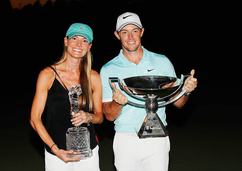 Rory McIlroy And Erica Stoll holding up a trophy