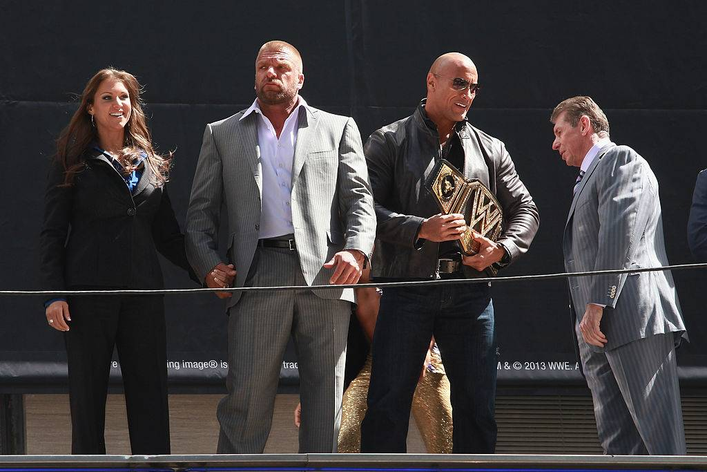 Triple H on stage with The Rock