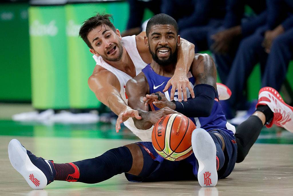 Kyrie Irving with player on his back