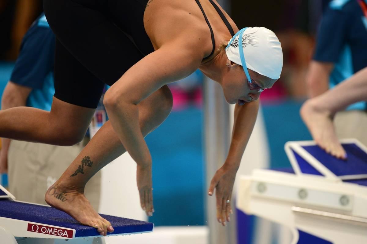 Federica Pellegrini dives into the pool.